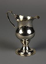 An Elegant Georgian Silver Cream Jug bearing