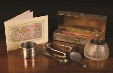 A Small Collection of Silver: A silver mounted cut glass inkwell hallmarked London 1896. A silver clad brass box of rectangular form decorated with diagonal fluting and hallmarked Birmingham 1898 with Mitchell Bosley & Co maker's mark. A Serviette ring hallmarked Birmingham 1929 with Sanders & Mackenzie makers' punch. A Georgian Caddy Spoon hallmarked Birmingham 1812 by John Turner. A Victorian Salt Spoon by William Robert Smily hallmarked London 1854. A pair of wishbone sugar tongs hallmarked  Birmingham 1946. And an embroidered greetings card.