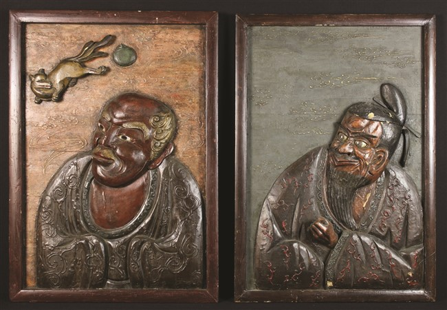 A pair of japanese relief carved and lacquered panels each