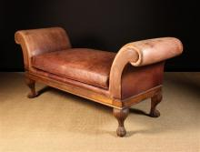 A Ralph Lauren Leather Chaise Longue, of good quality (bought from Libertys approx 20 years ago). The scroll arms, seat and swab cushion covered in 'shabby' finish burgundy leather edged with piping, standing on short carved oak cabriole legs with hairy paw feet. 30 ins (76 cms) high, 68½ ins (175 cms) long, 24 ins (60 cms) wide.