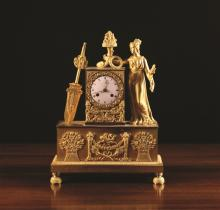 An Empire Ormolu Mantel Clock. The movement striking a bell with an enamelled dial set in a rectangular case embellished with ornately cast appliqués and mounted with the figure of Ceres to one side, holding a bundle of wheat and cornucopia of flowers. The plinth base ornamented with sheaths of flowers and wheat flanking a cherub to the centre, 15¾ ins (40 cms) high.