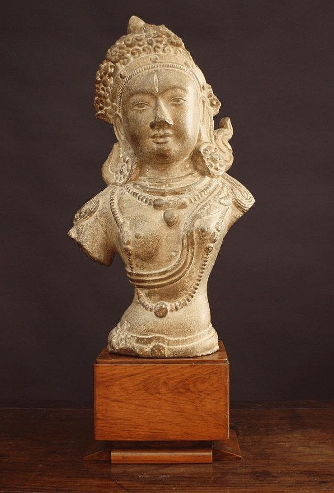 A Stone Carved Bust of Guanyin, mounted on a