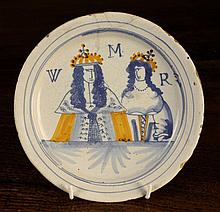 A Late 17th Century London Delft Plate, painted in