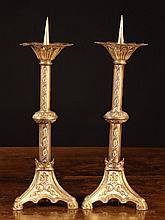 A Pair of Neo-Gothic Gilt Metal Pricket Sticks.