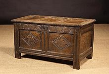 A 17th Century Oak Coffer. The triple panel lid in