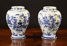A Pair of Blue & White Delft Vases decorated with