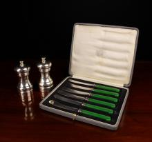 Two Silver Clad Pepper Grinders and a set of six green-handled butter knives. The pepper mills hallmarked London 1994 with M C Hersey & Son Ltd makers' stamp, the butter knives set in a presentation case marked A & N.G.S.Ltd Jewellers & Silversmiths Victoria St. London SW.