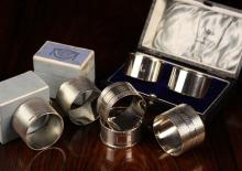 Seven Silver Napkin Rings: A pair by Collingwood & Sons Ltd hallmarked Sheffield 1938 machine engraved and initialled 'T' and 'O' in roundels. A Cased Pair by Walker & Hall hallmarked Sheffield 1942, and engraved with initials 'M' and 'D'. Two with Birmingham hallmarks one by Hukin & Heath Ltd dated 1944 the other  by Hukin & Heath Ltd dated 1969, and one sterling silver.