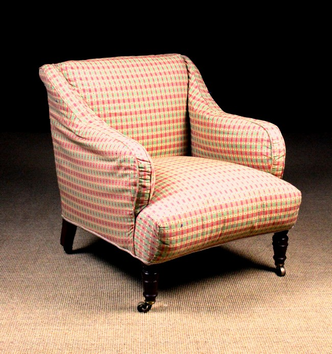 An Edwardian Upholstered Armchair Covered In A Green And Red
