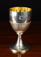 A Georgian Silver Goblet hallmarked London 1804 and stamped with John Emes maker's mark. The semi reeded bowl with gilt interior on a flared pedestal foot.