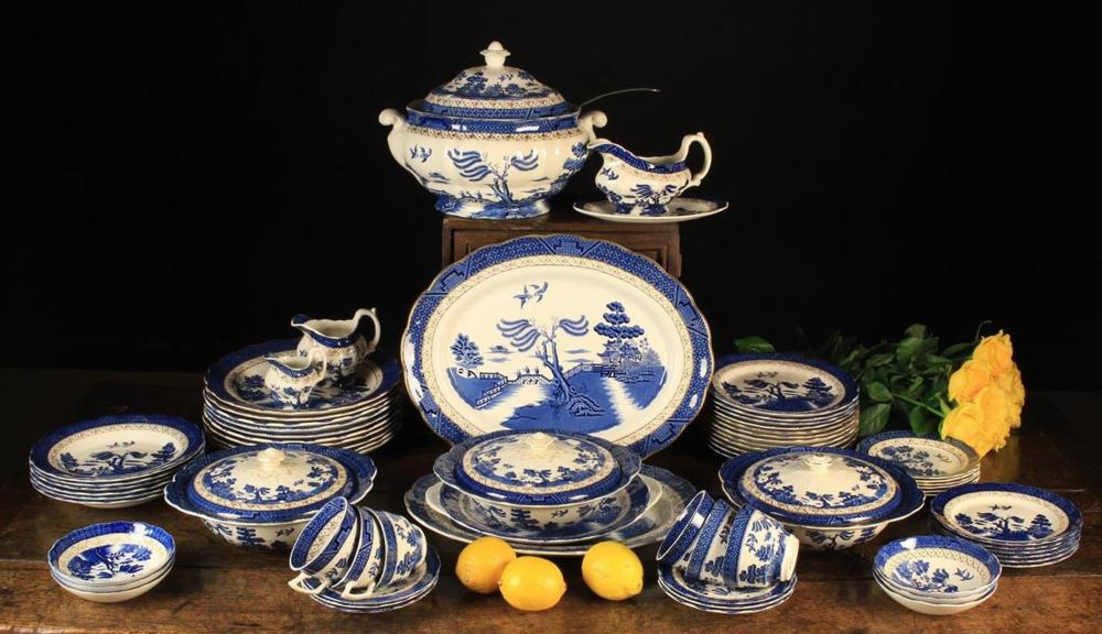 A Booths Blue & White Real Old Willow Dinner Set comprisi