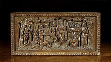 An 18th Century Carved Oak Panel depicting a