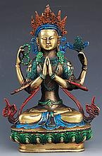 A FINELY CARVED TIBETANFOUR ARM GUAN YIN BUDDHA