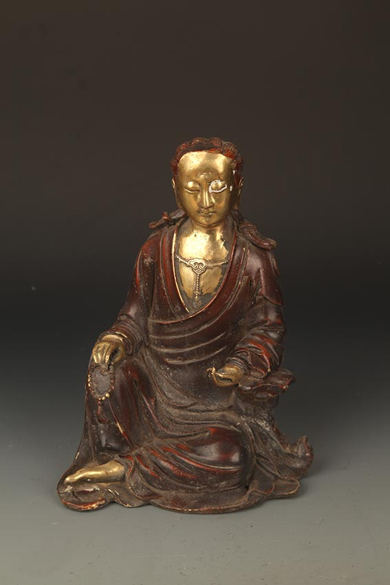 A FINELY CARVED BUDDHA FIGURE