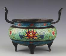 A COLORFUL BRONZE AND ENAMEL COLOR CENSER