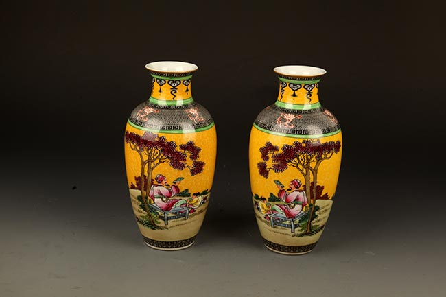PAIR OF DECOREATIONAL PORCELAIN BOTTLE