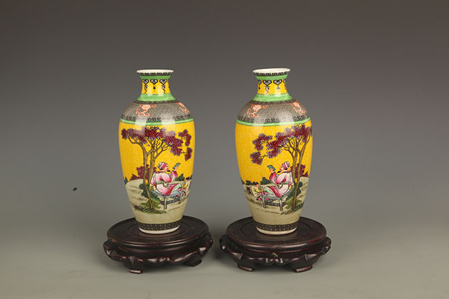 PAIR OF YELLOW GROUND STORY PORCELAIN VASE
