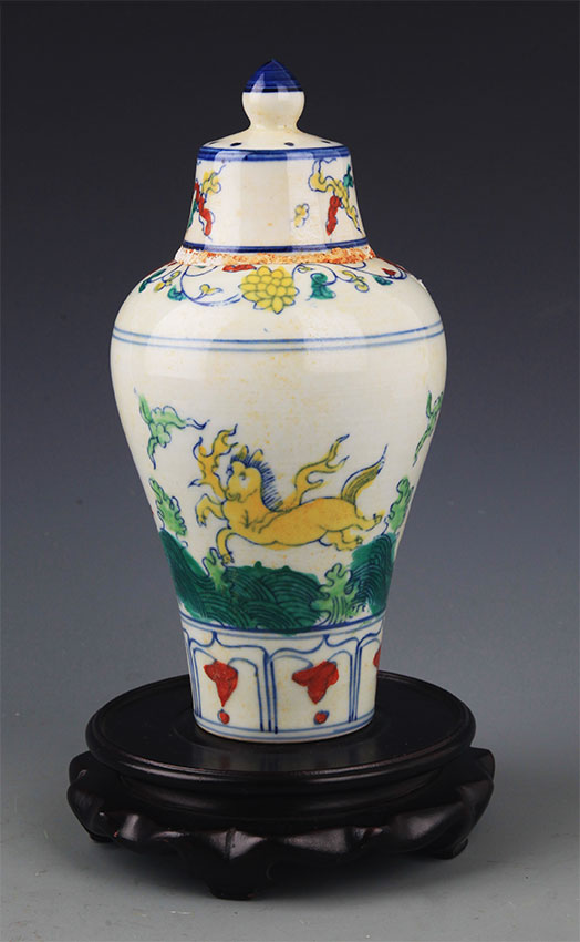 A YELLOW COLOR GLAZED CARVED FLOWER BOTTLE