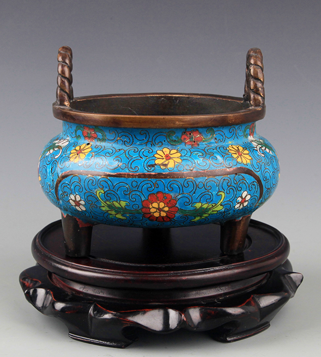 A BRONZE AND ENAMEL COLORED CENSER