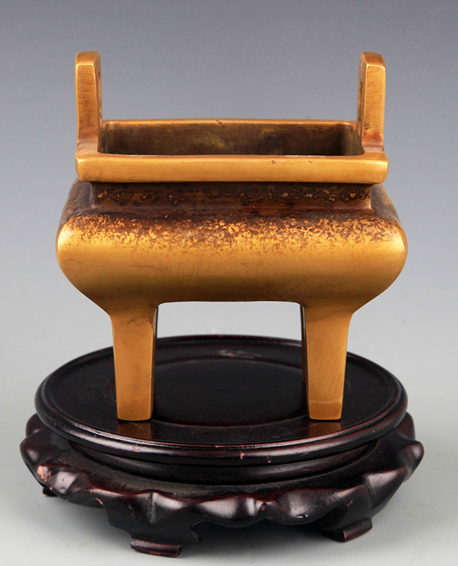 A DOUBLE EAR HIGH FOOT BRONZE CENSER