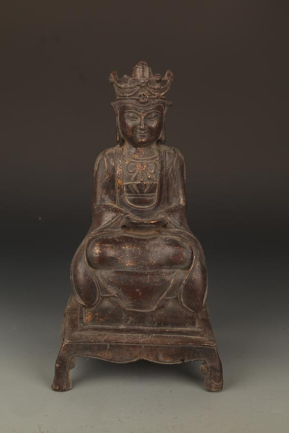 A FINELY CARVED BRONZE GUAN YIN BUDDHA
