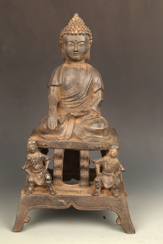 A CAST IRON AKSHOBHYA BUDDHA