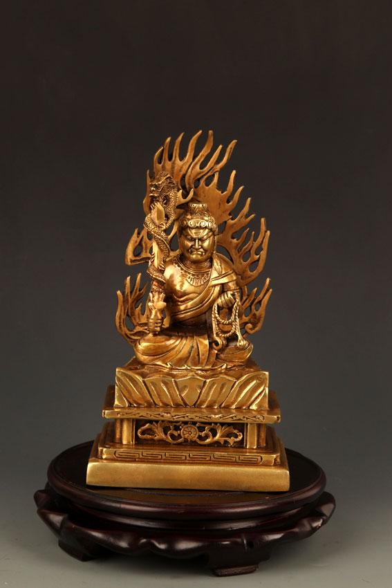 A BRONZE TIBETAN FUDO BUDDHA