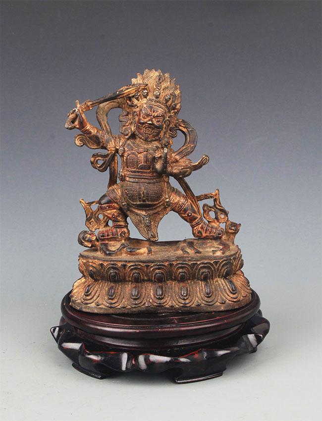 A GILT BRONZE AKSHOBHYA BUDDHA