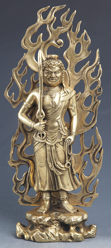 A TALL AND FINELY CARVED TIBETAN BUDDHA