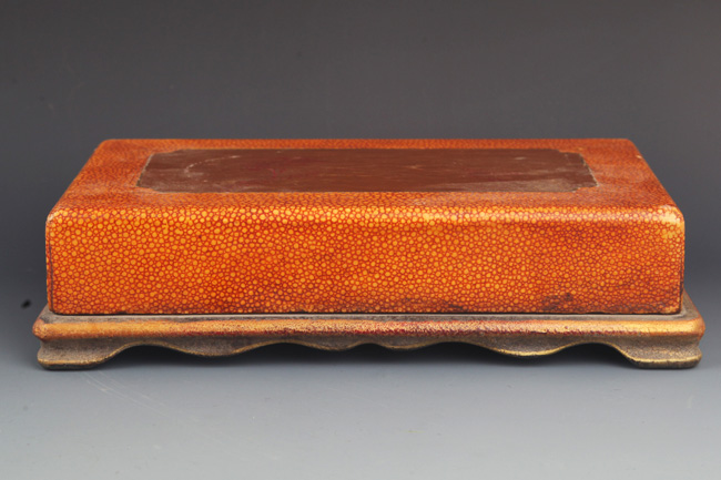 A GILT LACQUERED WOOD INK BOX