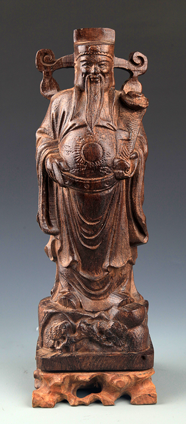 A FINE GOD OF WEALTH AGAR WOOD DECORATION