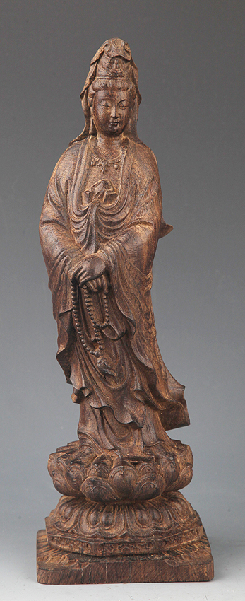 A FINELY CARVED AGAR WOOD GUANYIN