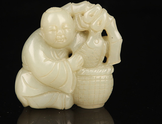 A BOY WITH FISH FIGURE GREENISH WHITE JADE