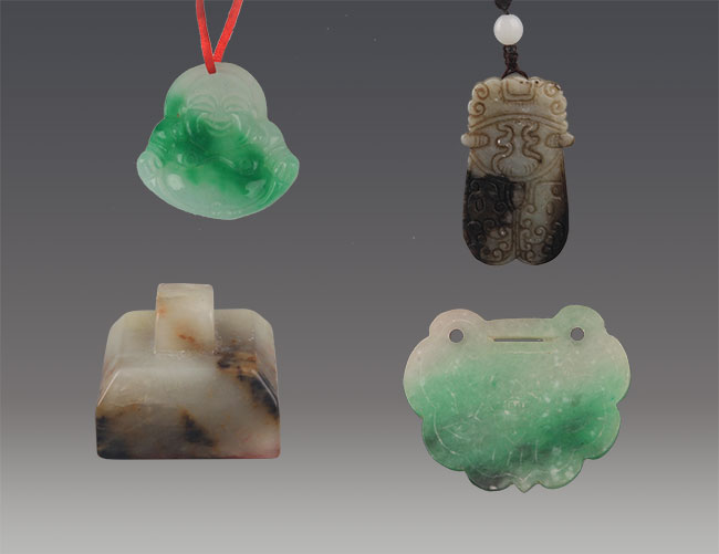 GROUP OF 4 GREENISH JADE AND JADEITE PENDANT