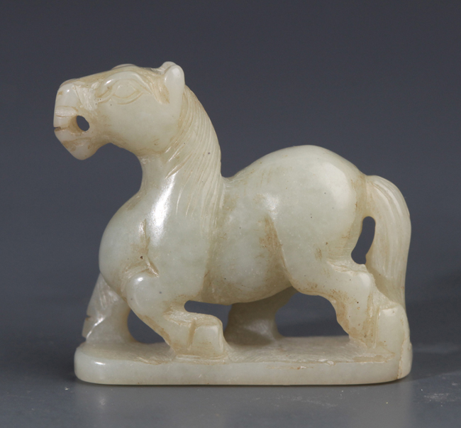 A HORSE SHAPE GREENISH WHITE JADE DECORATION