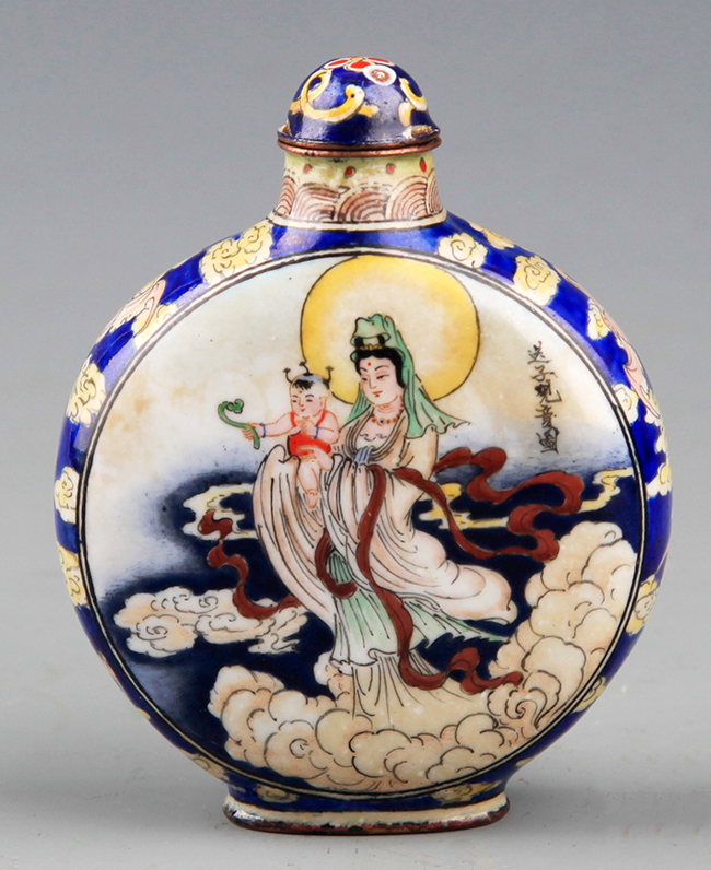 A BRONZE AND ENAMEL COLORED GUAN YIN SNUFF BOTTLE