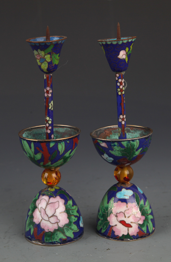 A PAIR OF PAINTED BRONZE CLOISONNÉ CANDLESTICKS