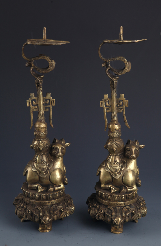A PAIR OF BRONZE SHEEP FIGURE CANDLESTICKS