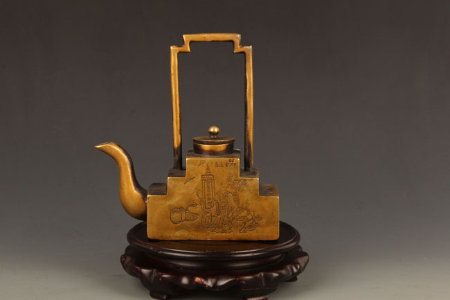 A FINELY CARVED BRONZE TEA POT