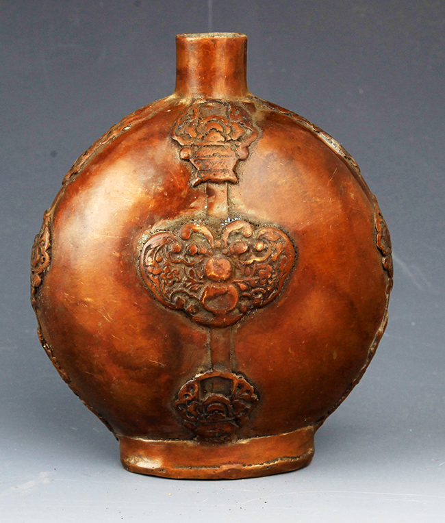 A FINELY CARVED BRONZE WINE BOTTLE