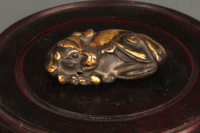 A GILT BRONZE RUI SHOU FIGURE PAPER WEIGHT