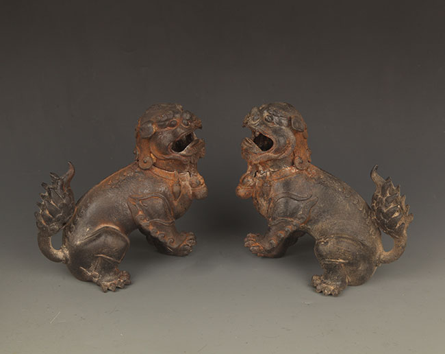 A PAIR OF CAST IRON LION