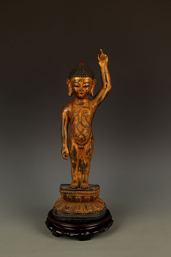 A TALL BRONZE BUDDHA FIGURE