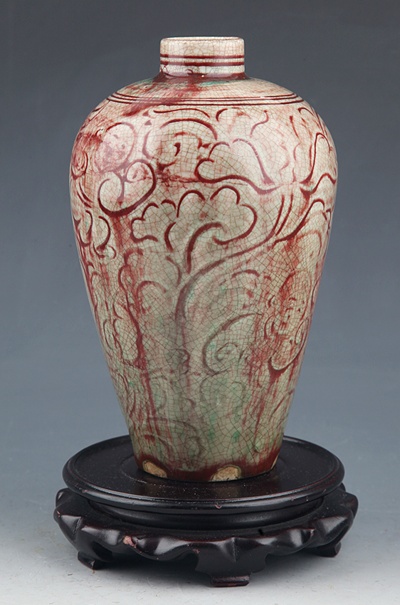 A RED COLOR FINELY CARVED PORCELAIN BOTTLE
