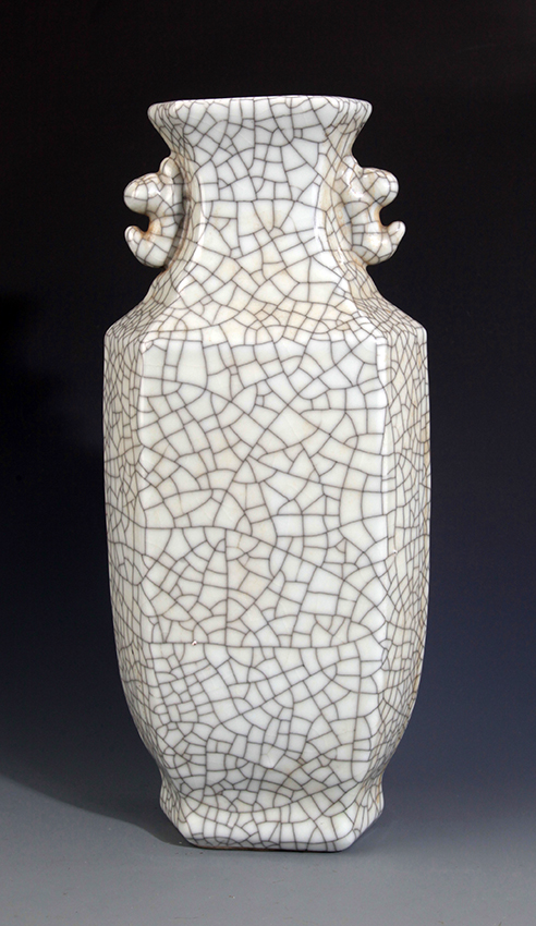 A TALL HEXAGONAL SHAPED DOUBLE EAR PORCELAIN BOTTLE