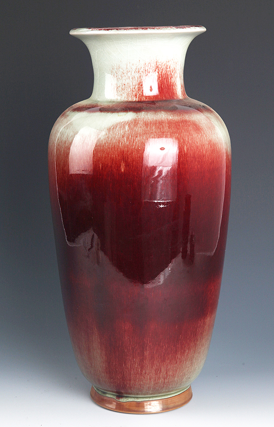 A RED COLOR PORCELAIN BOTTLE,