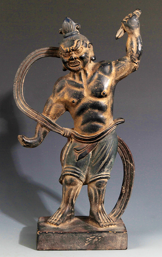 A FINELY CARVED BRONZE DEITY FIGURE