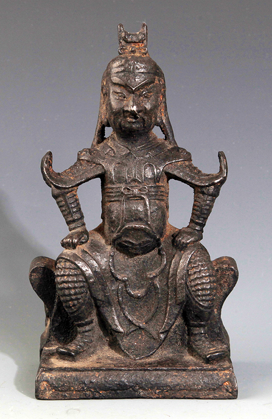 A FINELY CARVED IRON MADE DEITY FIGURE