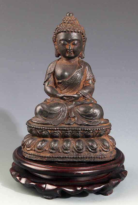 A FINELY CARVED IRON MADE AKSHOBHYA BUDDHA