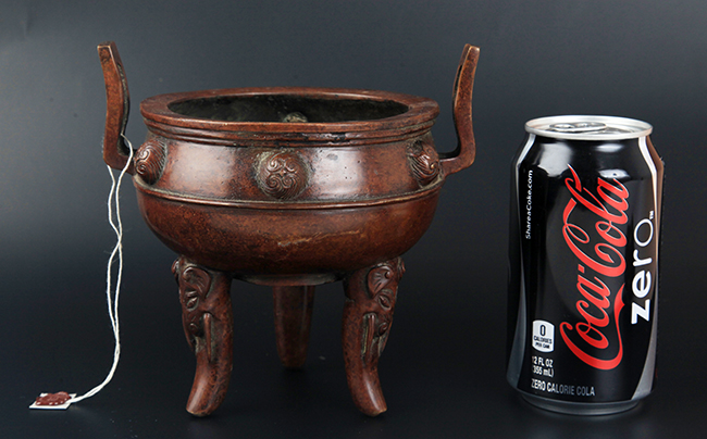 A TALL AND FINELY CARVED BRONZE CENSER